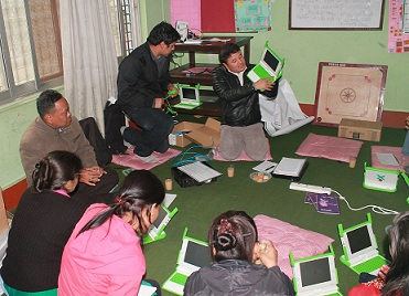 OLE Nepal staff introducing XO laptops to participants