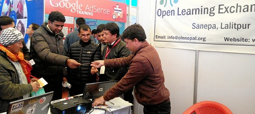 OLE Nepal member sharing information with visitors