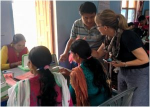Marianne Kujala-Garcia from Embassy of Finland interacting with teachers and trainer at the refresher training in Chainpur