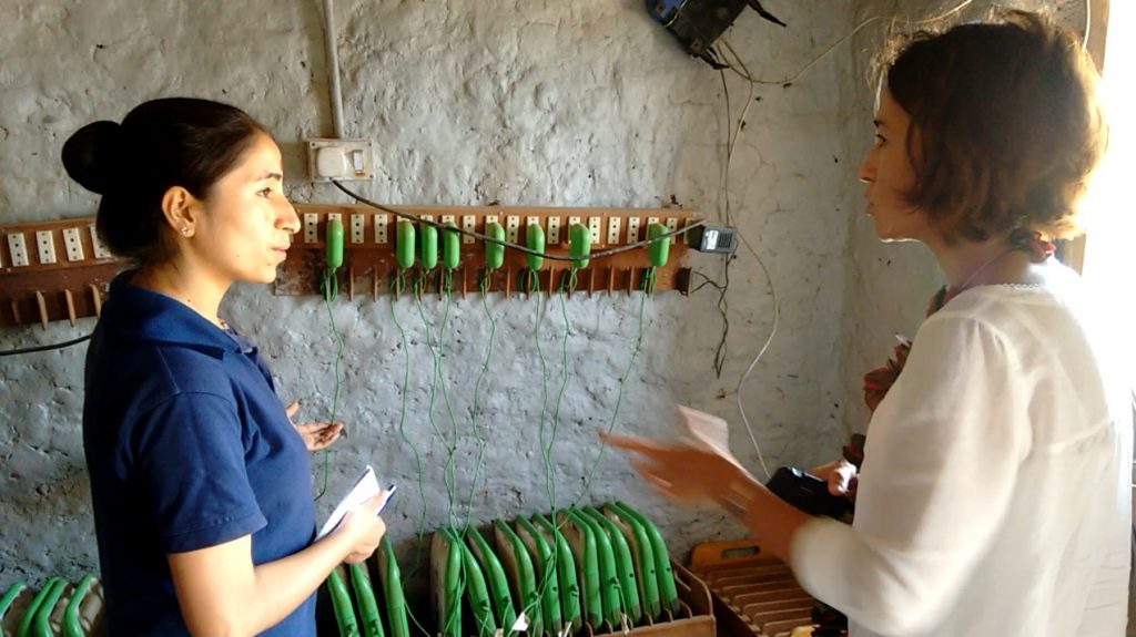 OLE Nepal's Deepa Thapa explaining the laptop program to USDA's Alessandra McCormack