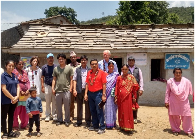 Alessandra McCormack, Program Analyst from USDA (third from left) with school teachers, parents, and OLE Nepal, WFP & FFE staff