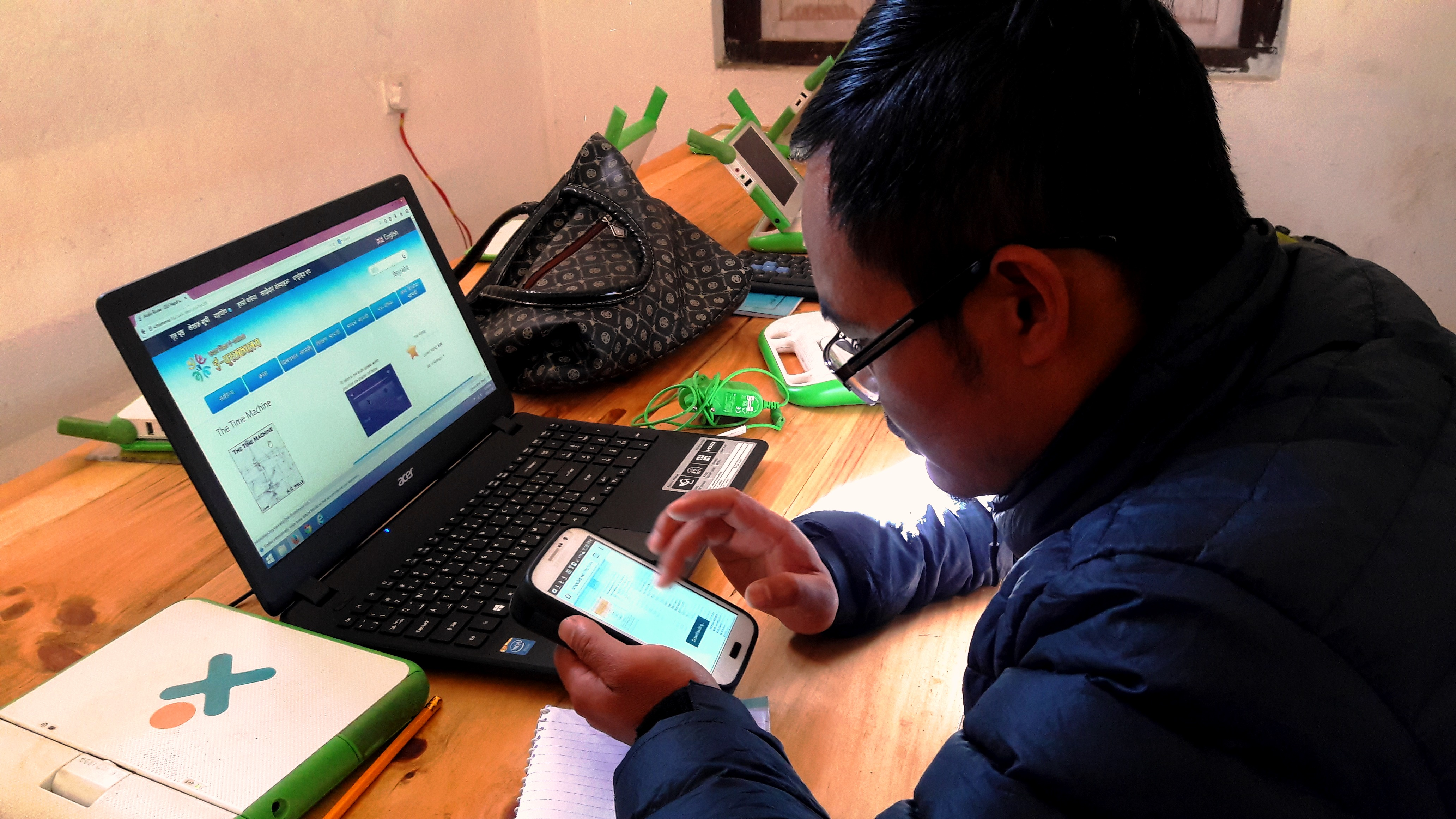 Teacher using E-Pustakalaya App on Android Device
