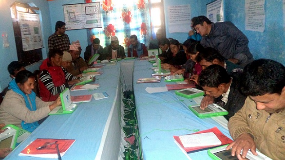 OLE Nepal members providing training on operating XO laptops