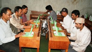 Teachers exploring E-Pati (laptops) after installation of E-Paati in their school