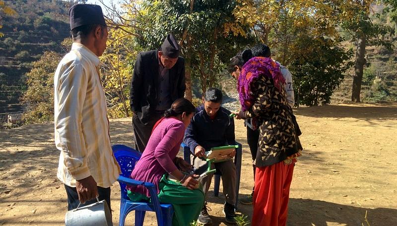 Fixing laptop problems at Samaiji Primary School, Haat